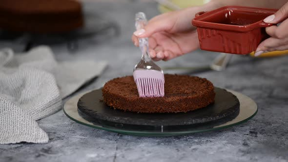 Thumbnail for Unrecognizable Female Confectioner Hand Soaks Sponge Cake with Sweet Juice Using Silicon Cooking