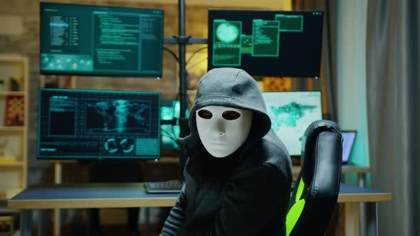 Masked Hacker Wearing a Hoodie To Hide His Identity