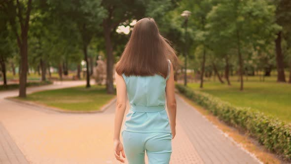 Thumbnail for Back View Close Up Woman Walking on the Street Turn Face To the Camera City Park Summer Outdoors