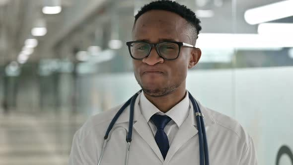Thumbnail for Portrait of Serious Male African Doctor Saying No By Head Shake