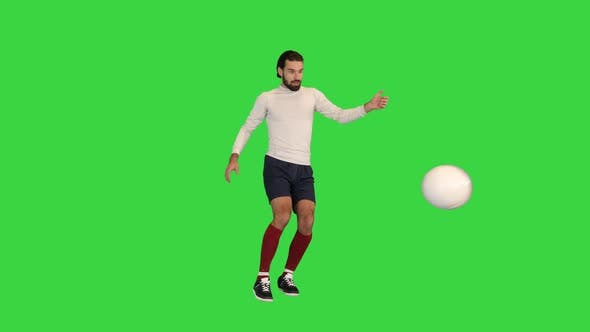 Football Player Hits the Ball and Celebrates a Goal on a Green Screen Chroma Key