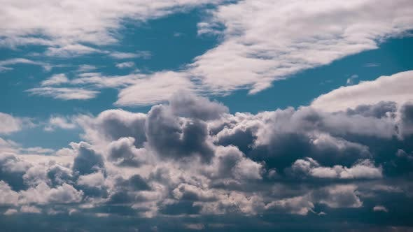 Timelapse of Gray Cumulus Clouds Moves in Blue Dramatic Sky Cirrus Cloud Space