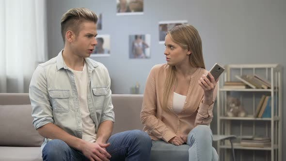 Boy Trying to Take His Phone From Jealous Girl, Misunderstanding in Relationship