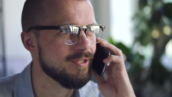 Thumbnail for Man Office Worker Talking on the Smartphone with Smile in Office Closeup. Business Discussion. Spbd