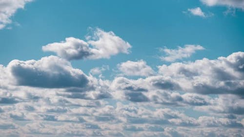 Timelapse of Cumulus Clouds Moves in Blue Dramatic Sky Cirrus Cloud Space