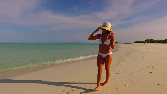 Thumbnail for Beautiful fun woman on holiday by the sea on beach on summer white sand and blue background