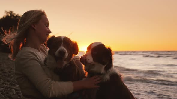 Cover Image for Woman with Two Beloved Dogs Resting By the Lake