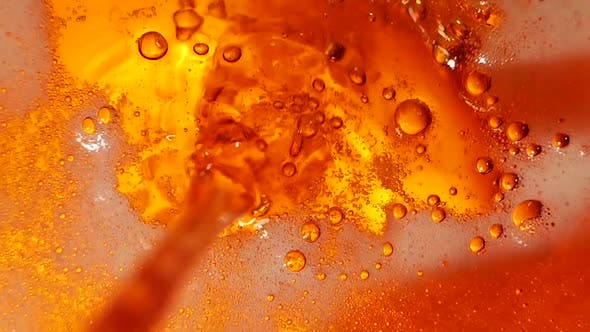 Pouring Beer in High Definition. Closeup. Slow Motion