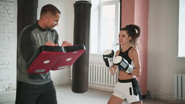 Training Fight of Male and Female Kickboxers