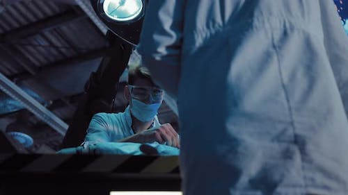 Surgeon Concentrates on the Operation