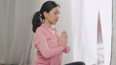 Beautiful caucasian female making yoga in quarantine at home.