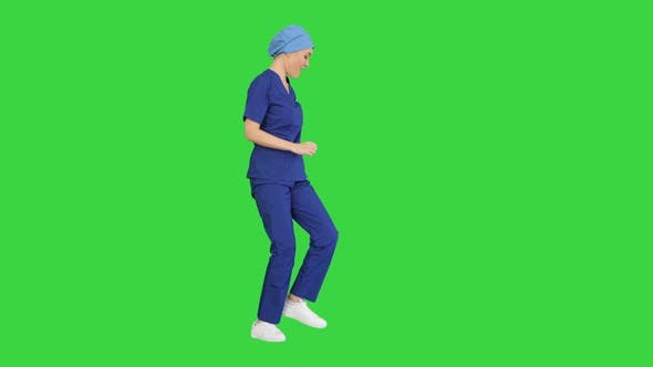 Girl Doctor Is Dancing and Walking on a Green Screen, Chroma Key