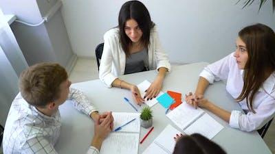 Cheerful Business People Brainstorming in Office