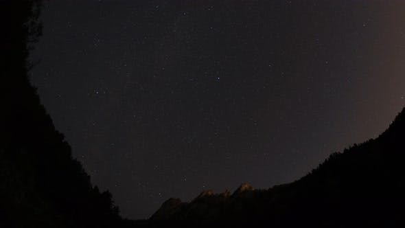 Thumbnail for Timelapse of the Starry Sky Above the Mountain Peaks in the Siberian Forest. Krasnoyarsk Nature
