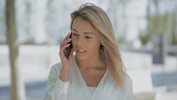 Thumbnail for Serious Businesswoman Talking By Cellphone