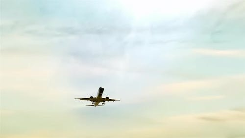 Airplane flying on a Cloudy Day. 4K Version.