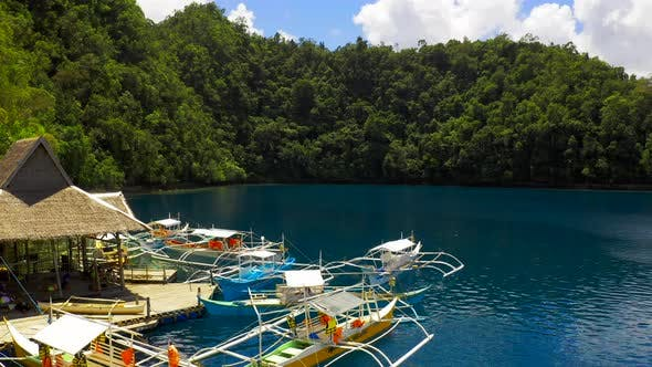 Cover Image for Aerial View Boat Pier in a Beautiful Tropical Bay on Sugba Lagoon in Siargao, Philippines.
