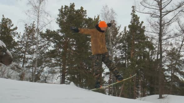 Thumbnail for A Young Man Snowboarding