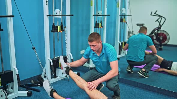 Thumbnail for Young Man Doing Exercises Under Physiotherapist Supervision