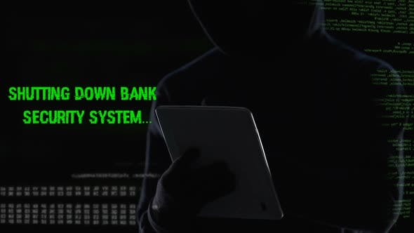 Thumbnail for Criminal Shutting Down Bank Security System on Tablet, Illegal Funds Transfer
