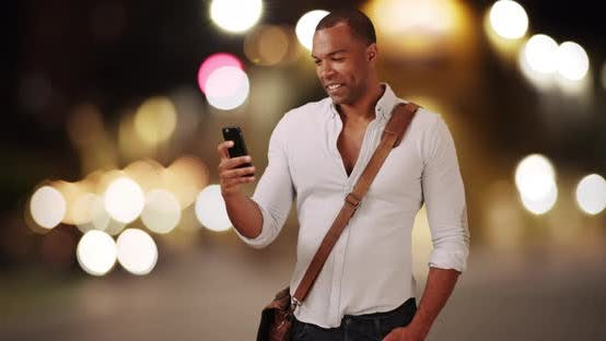 Thumbnail for A young black man records video on his mobile phone