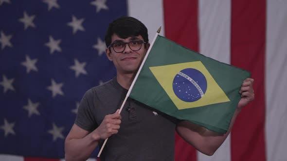 Man holding up the Flag of Brazil