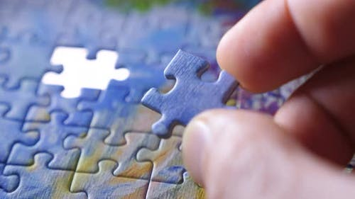 Finding the Solution Concept. Hand Matching Jigsaw Halves. Leisure Activity. Achieving the Goal Step