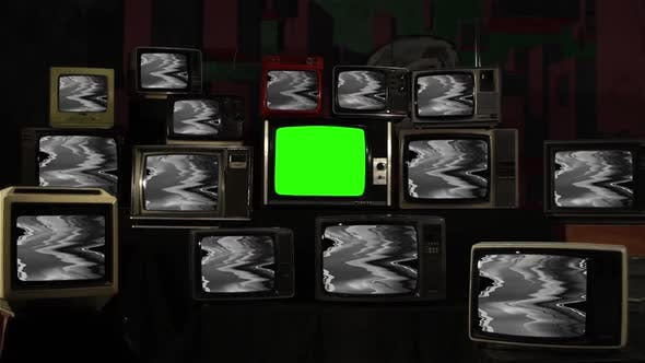 Thumbnail for Stack of Vintage TVs with Glitch Effect and A Green Screen.