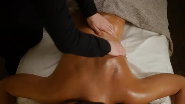 Cover Image for Close Up Therapeutic Massage of the Female Shoulders and Neck. Male Hands Doing Professional Massage