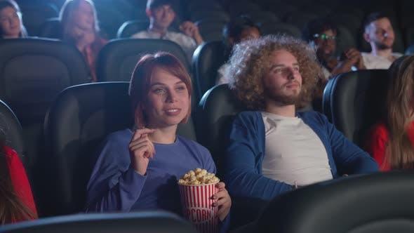 Multiracial People Watching Boring Movie Cinema