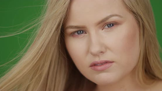 Thumbnail for Close up of attractive Caucasian woman looking into the camera on green screen