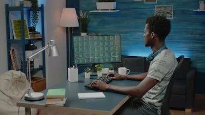 Black Business Man Looking at Stock Market Analysis