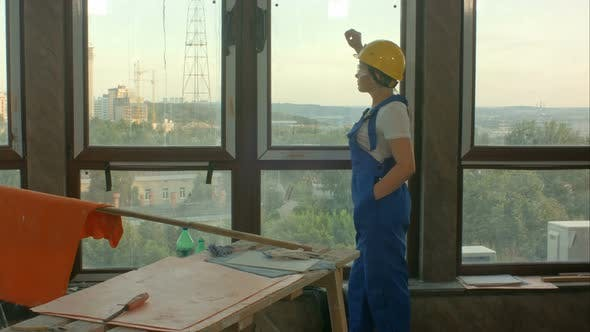 Thumbnail for Worker Taking Break From Work at Window and Look Into the Distance