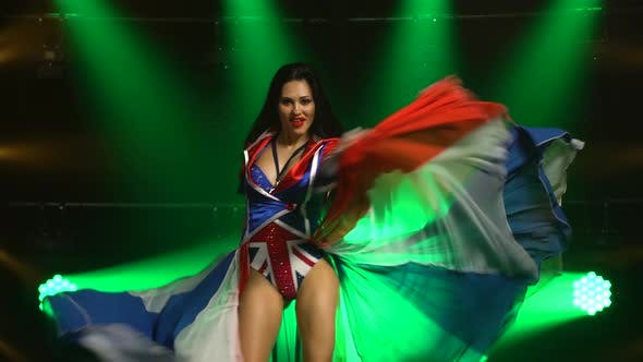 Thumbnail for Passionate Girl Dancing in a Sexy Suit in the Color of the English Flag and Rhinestones. Attractive