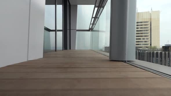 Thumbnail for Camera Captures a New, Modern Balcony and It's Wooden Floor, Goes From One Side To Another.