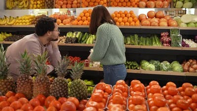 Picky Shopper Choosing Products in Supermarket
