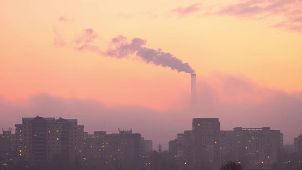 Industrial Refinery Tower with Building Silhouette in the City at Sunset -Time Lapse