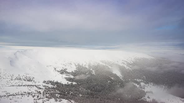 Snowy Mountain Peak in the Clouds