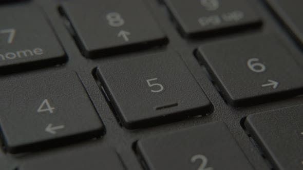 Thumbnail for The Finger Presses a Button with a Number on the Keyboard