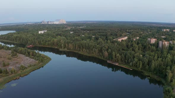 Drone Flight Over Deserted Pripyat River and Town