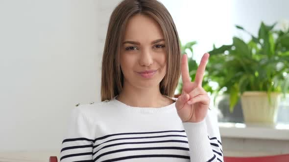Thumbnail for Beautiful Young Woman Gesturing  Victory Sign
