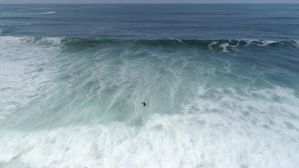 Thumbnail for Aerial view of a surfer in the ocean