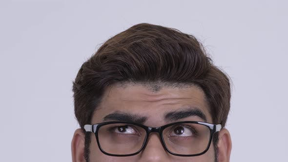 Thumbnail for Eyes of Young Indian Hipster Man with Eyeglasses Thinking
