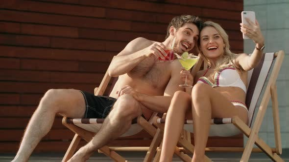 Thumbnail for Happy Couple Making Selfie Photo with Mobile Phone Near Pool