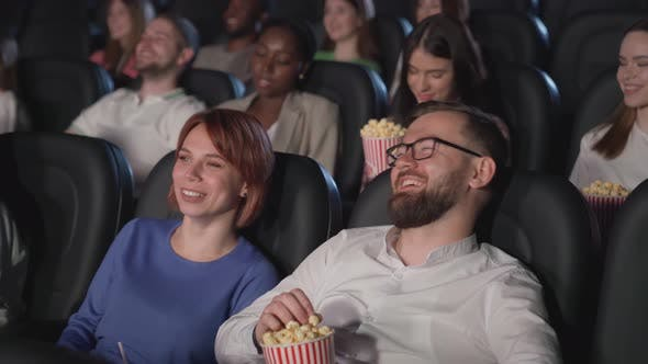 Thumbnail for Multiracial Young Adults Enjoying Comedy in Cinema.