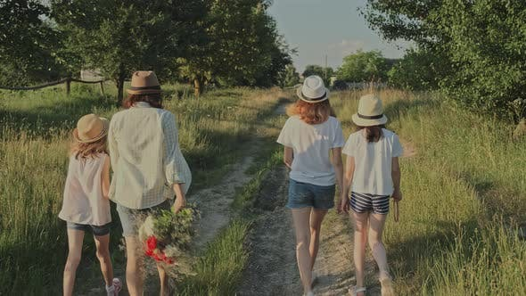Cover Image for Mother Walking with Her Daughters, Woman Holding the Hand of Child