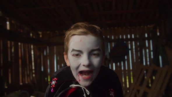 Thumbnail for Boy in Halloween Vampire Costume Frighten