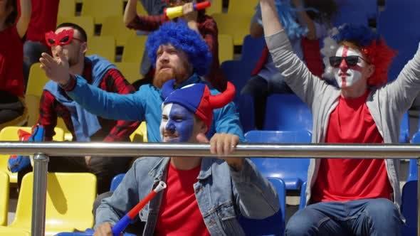 Thumbnail for Caucasian Mates Watching Match at Stadium and Celebrating Win