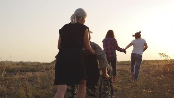 Thumbnail for Soldier and Family Enjoying Afternoon on a Meadow