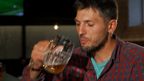 Thumbnail for Mature Man Smiling To the Camera While Drinking Beer